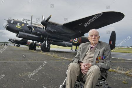 Mcc0056738 Spectators and war veterans had the rare opportunity at Biggin Hill Airport today to see two Arvo Lacncaster bombers fly side by side over UK skies for the first time since the filming of The Dambusters in the 1950's. The Lancaster were also escorted by two Spitfire planes. Pictured is Reg Humphries, 92, from Epsom, who was an engineer during World War 2 with the RAF with bomber command and fighter command from 1940-1946 and worked on many Lancaster bombers and Spitfires amongst other planes.