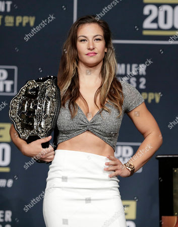 Miesha Tate poses for photographers during a UFC 200 mixed martial arts news conference,