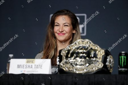 Miesha Tate smiles during a UFC 200 mixed martial arts news conference,