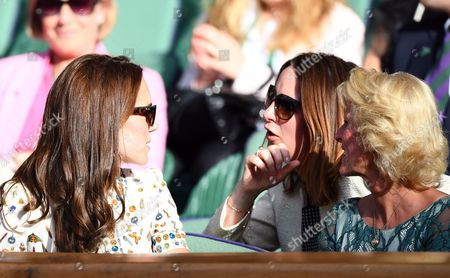 Stock Photo of HRH The Duchess of Cambridge, Catherine, talks to Rebecca Deacon, Catherine's Private Secretary, and Gill Brook during day fourteen of the 2016 Wimbledon Championships at the All England Lawn Tennis Club, Wimbledon, London on the 10th July 2016
