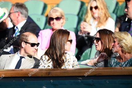 Stock Image of Prince William and Catherine Duchess of Cambridge, William and Catherine, talk to Rebecca Deacon, Catherine's Private Secretary, and Gill Brook during day fourteen of the 2016 Wimbledon Championships at the All England Lawn Tennis Club, Wimbledon, London on the 10th July 2016