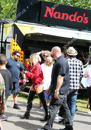 Fergie Duhamel catches the eye of Action Bronson at the Nando's Cock o'Van as she makes her way to the main stage at Wireless Festival in Finsbury Park, London.