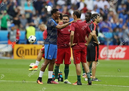 Anthony Martial of France with Ricardo Carvalho and Joao Moutinho of Portugal ahead of the UEFA Euro 2016 Final match between Portugal and France played at the Stade de France, Paris, France on July 10th 2016