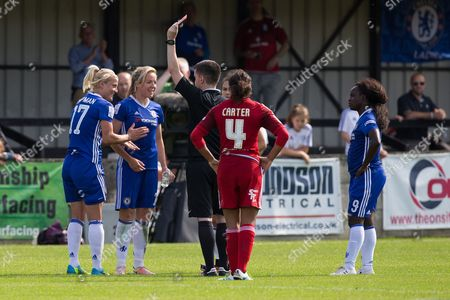 Chelsea captain Katie Chapman shown a red card after getting a second yellow  and applauds referee Christopher O'Donnell decision.
