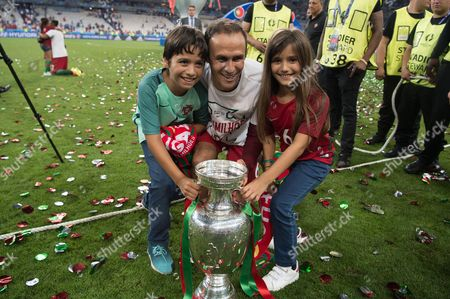 Portugal's Ricardo Carvalho celebrates with his children at the end
