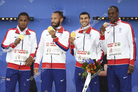 Britain's James Dasaolu, from left, Adam Gemili, Chijindu Ujah and James Ellington celebrate with their gold medals after winning the men's 4x100m relay final,