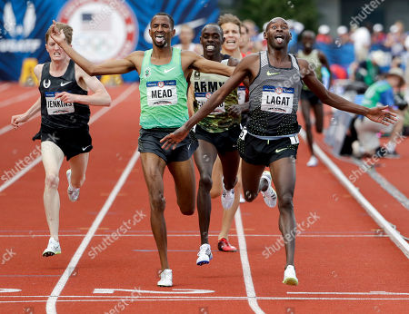 Bernard Lagat, right, wins in the finals of the men's 5000-meter run at the U.S. Olympic Track and Field Trials