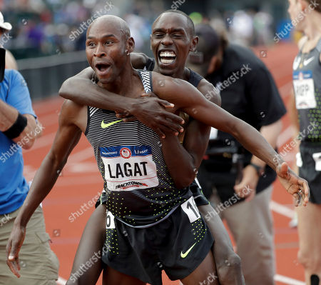 Bernard Lagat, left, celebrates his win in the finals of the men's 5000-meter run with Paul Chelimo at the U.S. Olympic Track and Field Trials