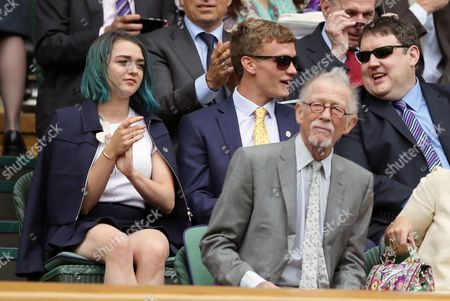 Actress Maisie Williams, left, comedian Peter Kay, right, and actor John Hurt, front, sit in the Royal Box on day thirteen of the Wimbledon Tennis Championships in London