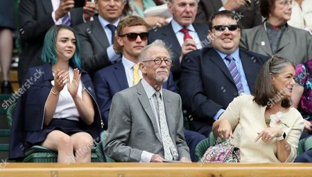 Actress Maisie Williams, left, comedian Peter Kay, second right, actor John Hurt, front centre, and his wife Anwen Rees-Myers, front right, sit in the Royal Box on day thirteen of the Wimbledon Tennis Championships in London