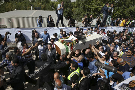 The coffin of Iranian film director Abbas Kiarostami is carried at his funeral ceremony in Tehran, Iran