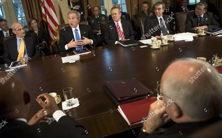 """President George W Bush meets with his cabinet in the Cabinet Room announcing the release of a White House report on the response to Hurricane Katrinia. In his remarks to the pool The President stated """"We will learn from lessons of the past to better protect the American people."""" From left to right: United States Secretary for Homeland Security Michael Chertoff, The President, United States Secretary of Defense Donald Rumsfeld, United States Secretary of Commerce Carlos Gutierrez, and United States Secretary of Transportation Norman Mineta. Also visible in the photo is Frances Fragos Townsend, Assistant to the President for Homeland Security and Counterterrorism (next to the American flag between Secretary Chertoff and The President). Vice President Dick Cheney is in the lower right foreground."""