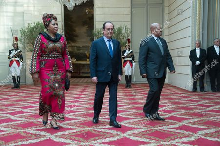 South African President Jacob Zuma, his wife Thobeka Madiba Zuma and French President Francois Hollande arrive for a state dinner at the Elysee Presidential Palace