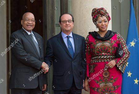 French President Francois Hollande welcomes South African President Jacob Zuma and his wife Thobeka Madiba Zuma for a state dinner in Zuma's honour at the Elysee Presidential Palace
