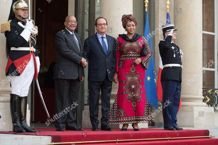 French President Francois Hollande welcomes South African President Jacob Zuma and his wife Stacy Thobeka Madiba Zuma at the Elysee Presidential Palace