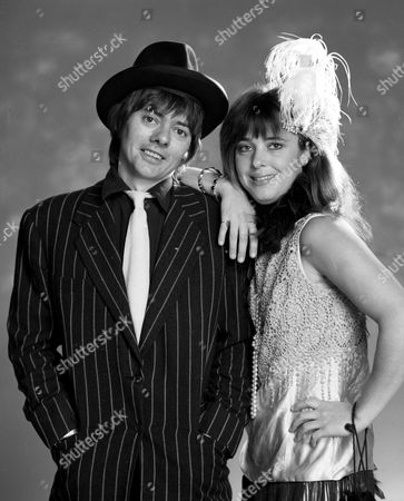 Jack Wild and Suzi Quatro pose in costume as a modern - day 'Bonnie & Clyde' couple for a proposed (but unmade) TV drama, early 1980s.