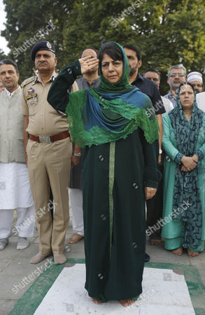 Jammu and Kashmir state Chief Minister Mehbooba Mufti lays a wreath on a grave at Martyr's Graveyard in Srinagar, Indian controlled Kashmir