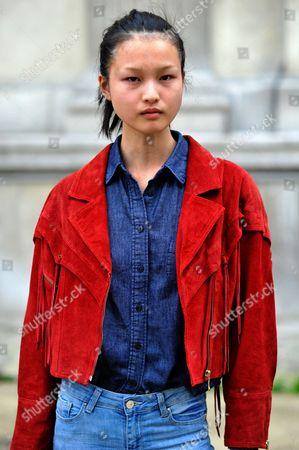 Model Xin Xie Model after Ulyana Sergeenko Haute Couture SS17 FW16, Galerie de la Mineralogie, Paris, 2016.