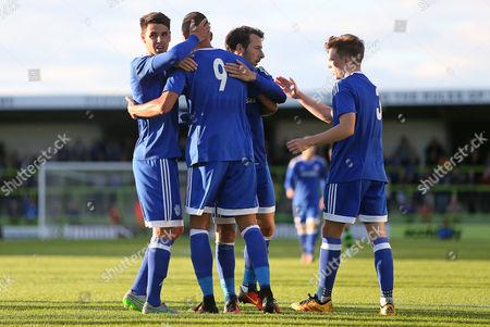 Federico Macheda of Cardiff City celebrates scoring a goal with team mates