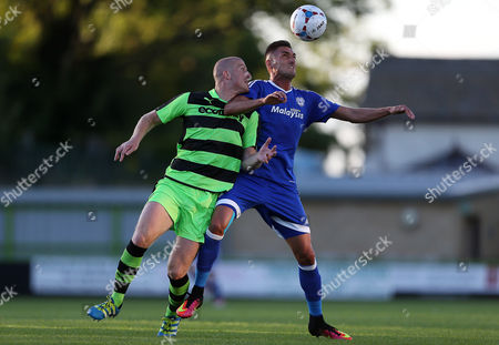 Federico Macheda of Cardiff City challenges Charlie Clough of Forest Green Rovers for the ball.