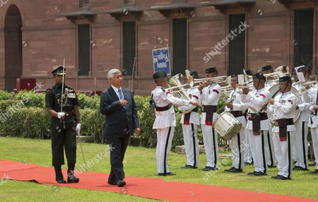 Japanese Defense Minister Gen Nakatani, second left, inspects a tri-service guard of honor upon his arrival at the Indian Defense Ministry in New Delhi