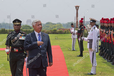 Japan's Defense Minister Gen Nakatani, second left, inspects an honor guard during a welcoming ceremony at India's Defense Ministry in New Delhi