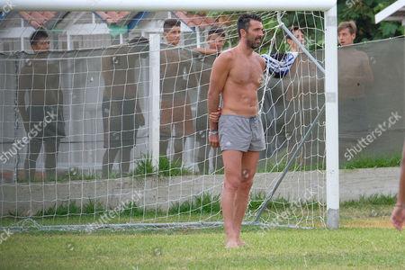 Gianluigi Buffon plays football in the rain