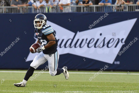 Toronto Argonauts wide receiver Larry Taylor (12) returns the ball