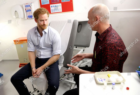 Prince Harry waits for the results of an HIV test taken by Specialist Psychotherapist Robert Palmer during a visit to Burrell Street Sexual Health Clinic
