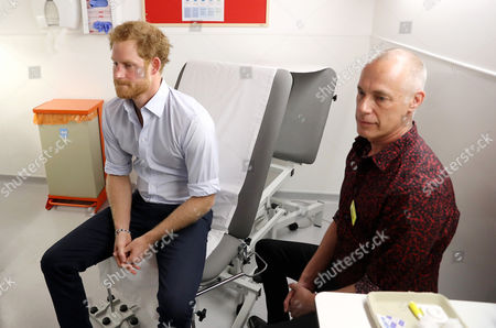 Prince Harry preares to have an HIV test taken by Specialist Psychotherapist Robert Palmer during a visit to Burrell Street Sexual Health Clinic