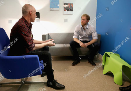 Prince Harry chats with Specialist Psychotherapist Robert Palmer in a councelling room as visits Burrell Street Sexual Health Clinic
