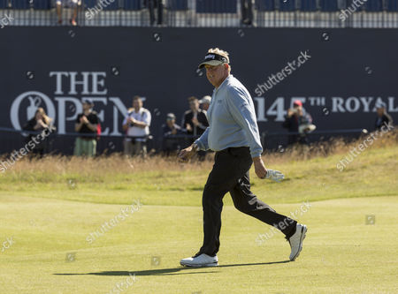 Scotland's Colin Montgomerie walks towards the green on 18th hole on day one of the 145th Open Championship held at Royal Troon, Scotland on July 14th 2016.