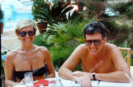John Fowler pictured with his wife, Linda on holiday. Police are in the middle of searching a farm building in Staplehurst, which Mr Fowler owns, in connection with the Securitas robbery of £53 million