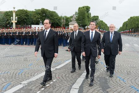 French Prime Minister, Manuel Valls, French Defense Minister, Jean-Yves Le Drian, French President, Francois Hollande and French Junior Minister for Veterans and Remembrance, Jean-Marc Todeschini during the annual Bastille Day military parade on the Champs-Elysees avenue