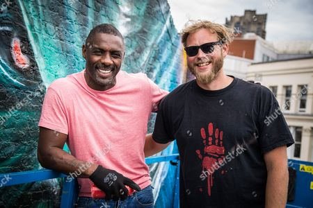 Stock Picture of Idris Elba and Graffiti artist Jim Vision bring the final touch to a street art mural of his Star Trek character 'Krall' during a photo call ahead of the release of the film 'Star Trek Beyond'