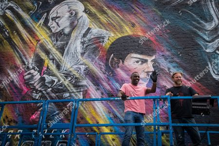 Stock Image of Idris Elba and Graffiti artist Jim Vision bring the final touch to a street art mural of his Star Trek character 'Krall' during a photo call ahead of the release of the film 'Star Trek Beyond'
