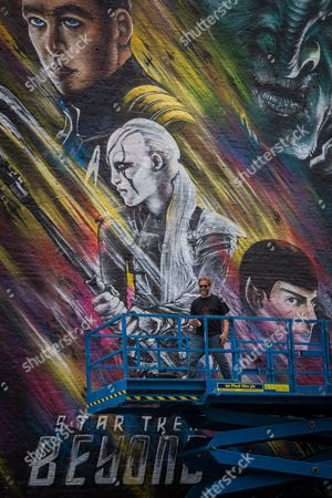 Stock Photo of Graffiti artist Jim Vision brings the final touch to a street art mural of the upcoming film 'Star Trek Beyond'
