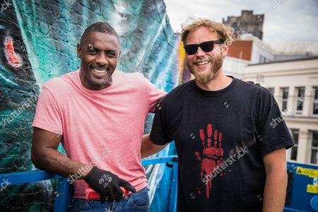 Idris Elba and Graffiti artist Jim Vision bring the final touch to a street art mural of his Star Trek character 'Krall' during a photo call ahead of the release of the film 'Star Trek Beyond'