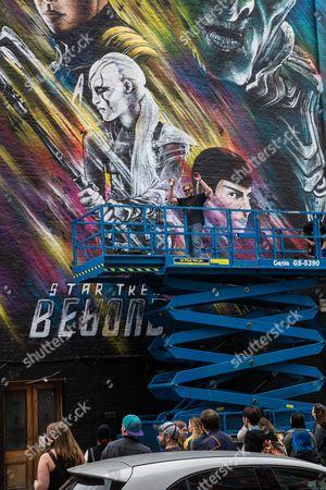 Graffiti artist Jim Vision brings the final touch to a street art mural of the upcoming film 'Star Trek Beyond'