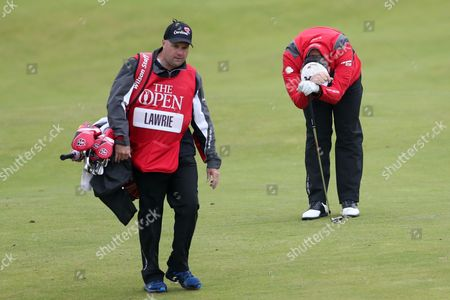 Paul Lawrie of Scotland, right, reacts after playing a shot from the 10th fairway during the second round of the British Open Golf Championship at the Royal Troon Golf Club in Troon, Scotland