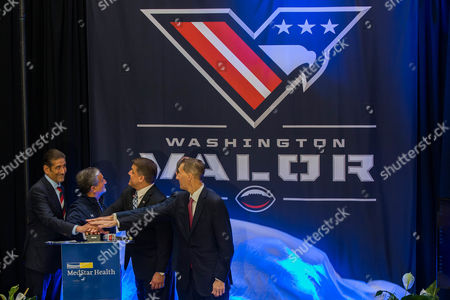 MSE Owner and AFL Managing Partner Roger Mody, MSE Majority Owner Ted Leonsis, AFL Head Coach Dean Cokinos, MedStar Chief Medical Officer Stephen Evans, and AFL Commissioner Scott Butera, from left to right, press a button to unveil the Washington Arena Football League's team name, logo, and color during a news conference