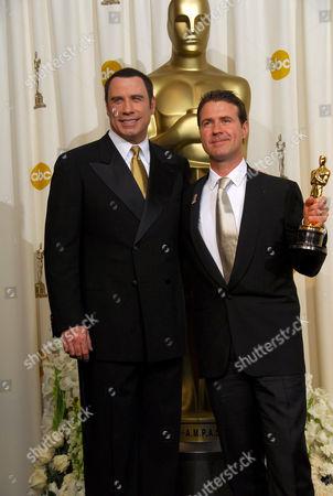 Stock Photo of John Travolta and Dion Beebe