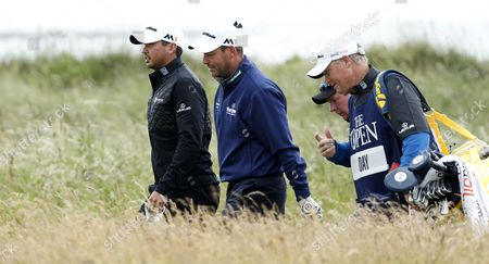 Jason Day of Australia, left, and David Howell of England walk the 2nd fairway during the third round