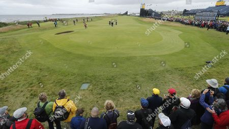 Crowd watch as Jason Day of Australia and David Howell of England play the 2nd green during the third round