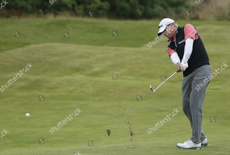 Steven Stricker of the US hits a shot on the 11th fairway during the final round