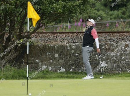Steven Stricker of the US reacts after narrowly missing a birdie chance on the 11th greenduring the final round