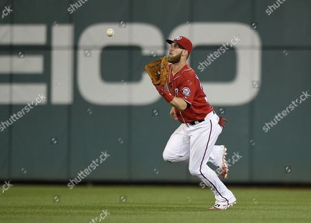 Washington Nationals right fielder Bryce Harper prepares to catch a line drive by Pittsburgh Pirates' Josh Harrison for the out during the fifth inning of a baseball game, Saturday, July 16, 2016, in Washington.