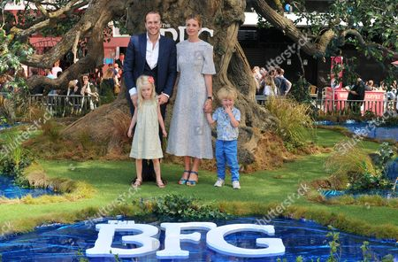 Stock Image of Rafe Spall, Elize Du Toit & their kids Lena Spall, Rex Spall
