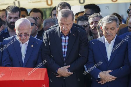 Turkish President Recep Tayyip Erdogan centre, accompanied by former president Abdullah Gul, right, prays during the funeral of his campaign manager Erol Olcak, killed Friday along with his 16-year old son Abdullah while protesting the attempted coup against Turkey's government, in Istanbul. Olcaks were killed when renegade soldiers opened fire on protesters at the Bosporus bridge in Istanbul on Friday night.