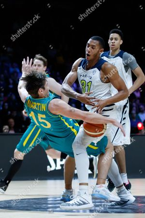 Stephen Domingo (31) of the California Golden Bears fouls Damian Martin (15) of Australia during game 2 of the Australian Boomers Farewell Series between the Australian Boomers and the American PAC-12 All-Stars at Hisense Arena in Melbourne, Australia